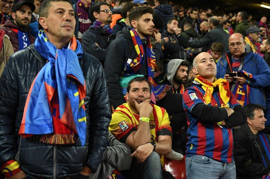 Barcelona fans react after losing 4-0 to Liverpool during the Uefa Champions league semi-final second leg football match between Liverpool and Barcelona at Anfield in Liverpool, on May 7, 2019.