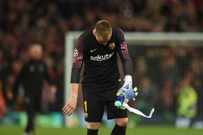 German goalkeeper Marc-Andre Ter Stegen reacts after losing 4-0 to Liverpool during the Uefa Champions league semi-final second leg football match between Liverpool and Barcelona at Anfield in Liverpool, on May 7, 2019.