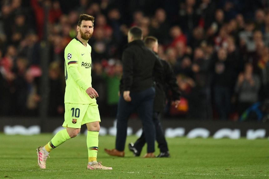 Barcelona's Argentinian striker Lionel Messi reacts after losing 4-0 to Liverpool during the Uefa Champions league semi-final second leg football match between Liverpool and Barcelona at Anfield in Liverpool, on May 7, 2019.