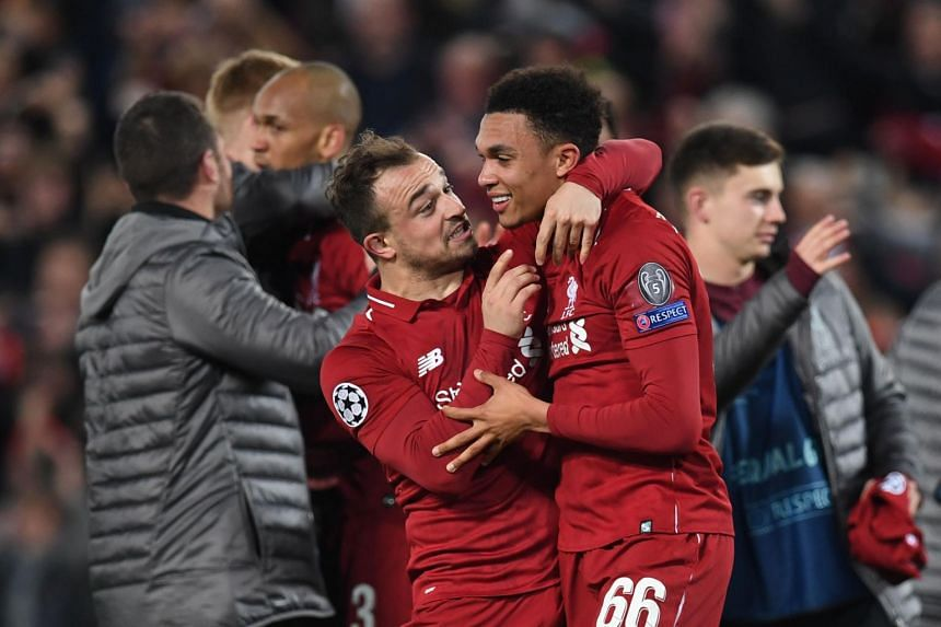 Liverpool's midfielder Xherdan Shaqiri (left) celebrates with defender Trent Alexander-Arnold after winning the Uefa Champions league semi-final second leg football match against Barcelona at Anfield in Liverpool, on May 7, 2019.