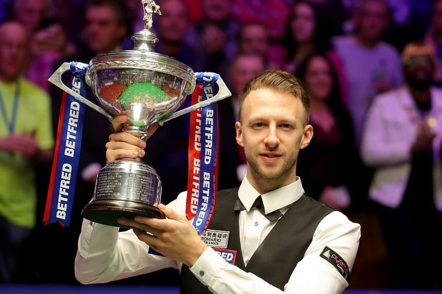 Judd Trump lifting the trophy after winning the snooker world title at the Crucible Theatre on Monday.