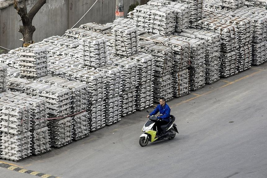 Aluminium stockpiles at a depot in China. Exports dropped 2.7 per cent last month, while imports expanded by 4 per cent.