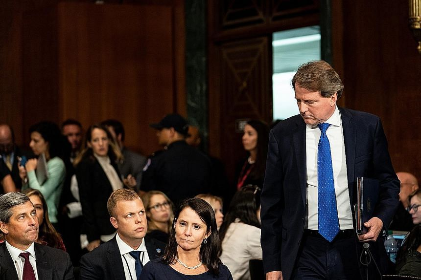 Mr Donald McGahn (standing, in a file photo) was earlier stopped by the White House from handing over documents subpoenaed by House investigators because US President Donald Trump may want to assert executive privilege.