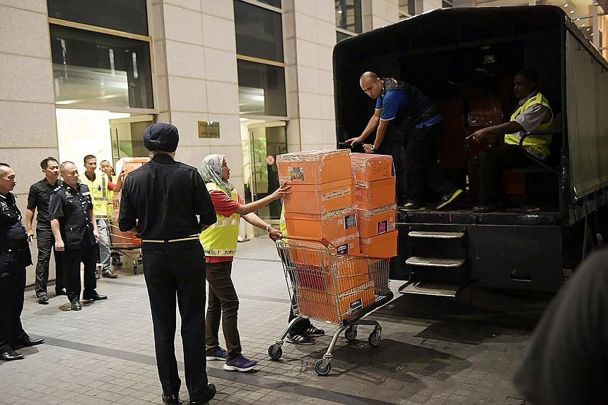 A police truck being loaded with items seized from a luxury condominium linked to former Malaysian PM Najib Razak last year. Najib will challenge the two suits that were filed on Tuesday, his lawyer Muhammad Shafee Abdullah said.