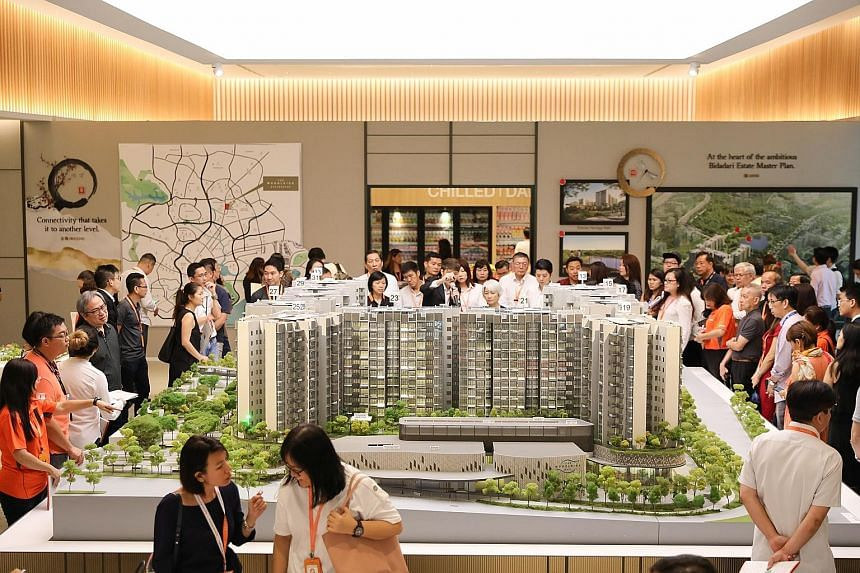 Visitors at a preview of The Woodleigh Residences yesterday, ahead of its launch on Saturday. The integrated development by Japanese developer Kajima Development and Singapore Press Holdings will include 667 residential units that feature Japanese te