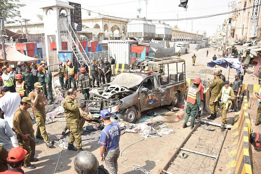 The bomb went off at a police checkpoint outside the Data Darbar shrine in Lahore a day after the start of Ramadan.