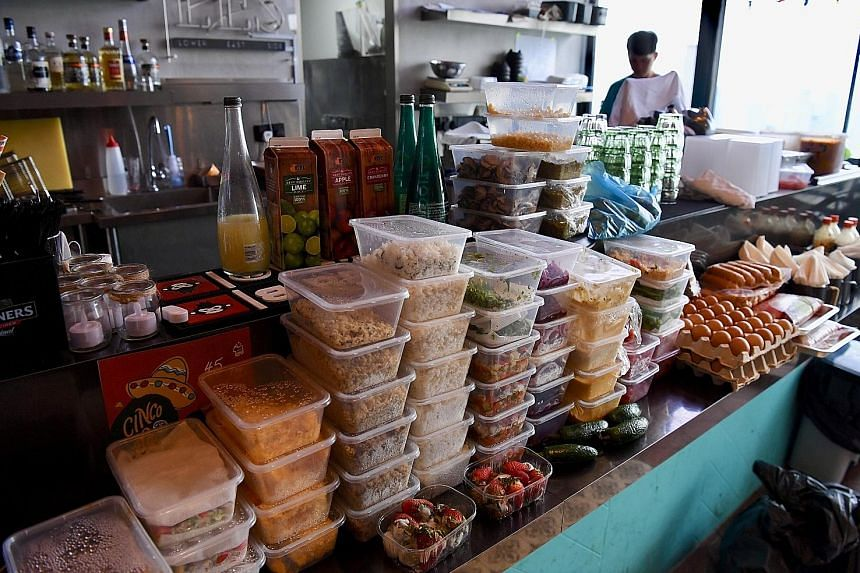 At Lower East Side 45 restaurant, several boxes of raw ingredients for cooking, as well as eggs and strawberries that had turned bad, were taken out for disposal.