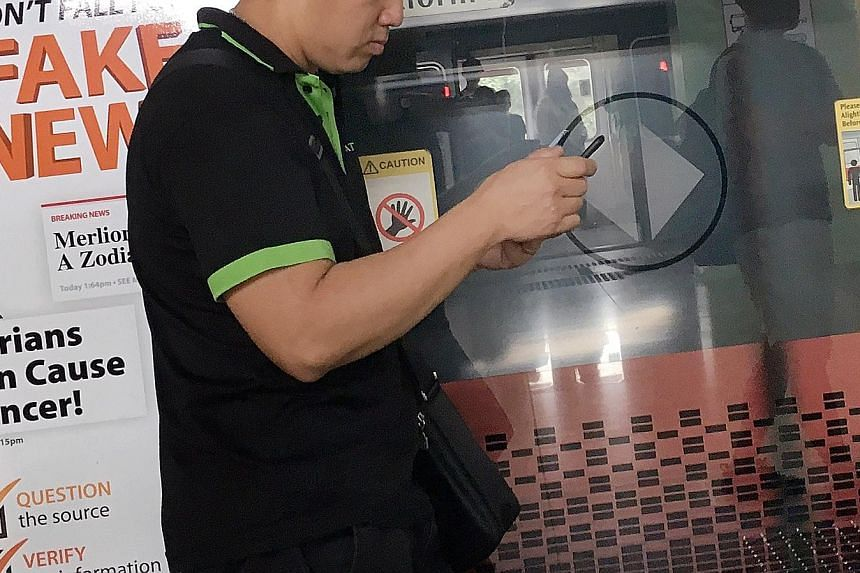 A poster warning about fake news at an MRT station in December last year. The new law gives ministers powers to order an individual to remove content that is deemed false or run a correction alongside it. It applies to statements of facts, and does n