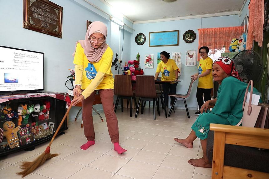 Volunteer Juzailah Abd Rahim 39, an assistant manager, cleaning the home of Madam Tumi Teron, 89, yesterday. As part of the Courts Charity Home programme, 14 Courts employee volunteers helped to deliver some products and cleaned the beneficiaries' ho