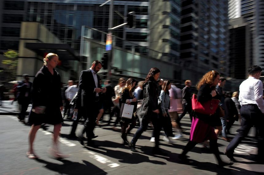 Pedestrians walking through Sydney's central business district. All the gains in employment for the year to February were in the public sector, some 292,900 in all.