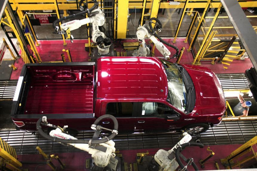 A 2014 Ford F150 truck goes through Quality Control on the assembly line at Ford's Dearborn Truck Plant in Dearborn, Michigan.
