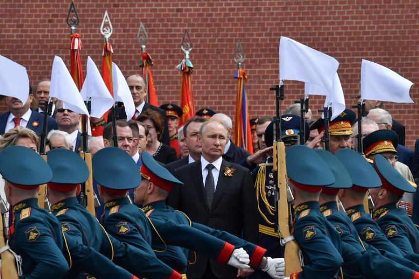 Russian President Vladimir Putin looking on as thousands of troops marched past and columns of tanks rumbled across the famous square in a display reminiscent of the Cold War era.