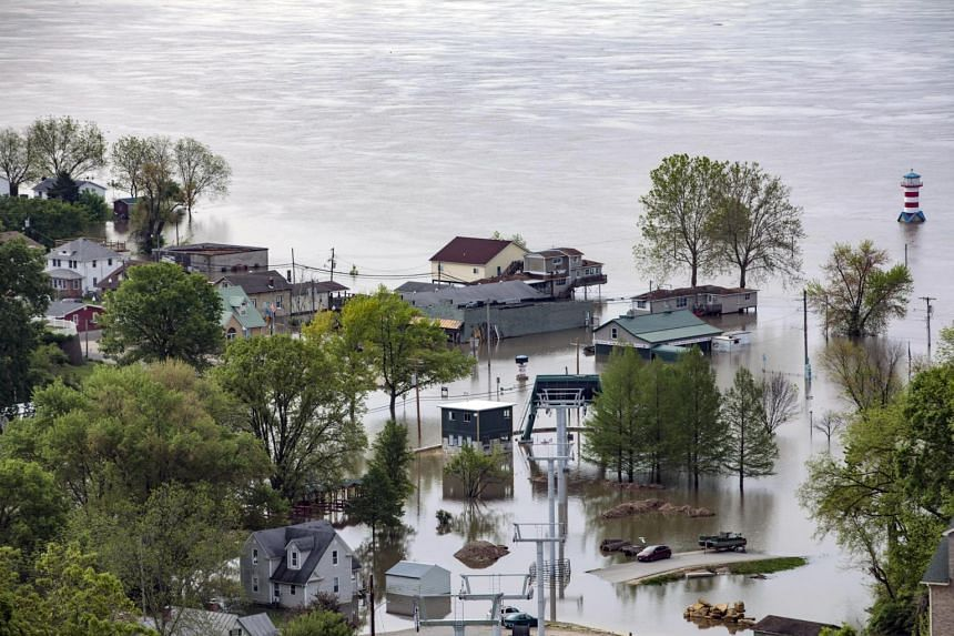 Homes and business in Grafton, Illinois, are inundated by floodwaters from the Mississippi River on May 6, 2019.