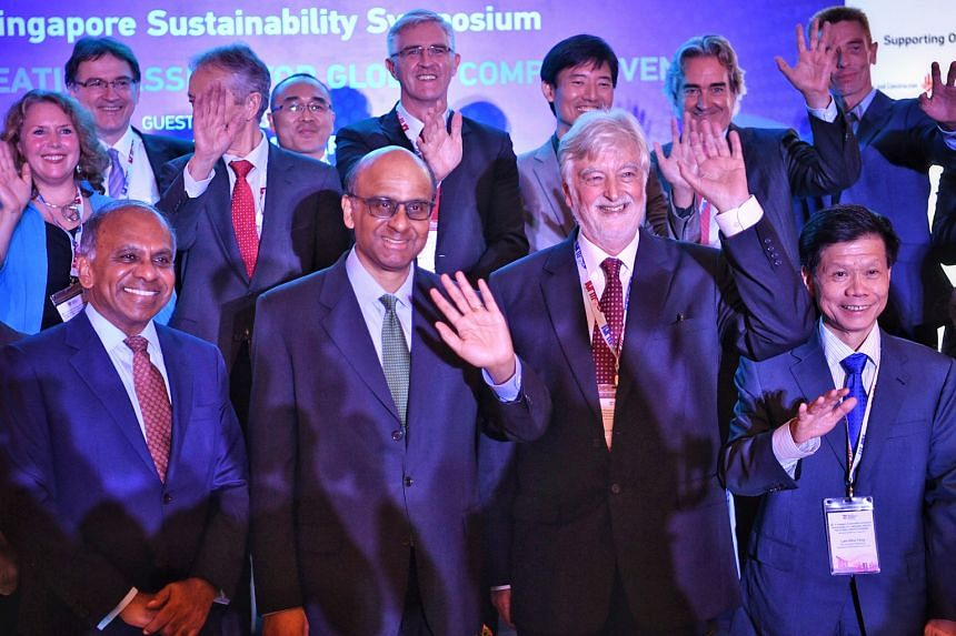 Senior Minister Tharman Shanmugaratnam - flanked by Nanyang Technological University president Subra Suresh (left) and Professor Alexander J. B. Zehnder, member of the university's board of trustees and chairman of its Sustainable Earth Office - with