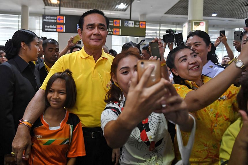 Mr Prayut Chan-o-cha, taking photos with supporters last month, has been nominated as prime minister by Palang Pracharath Party.