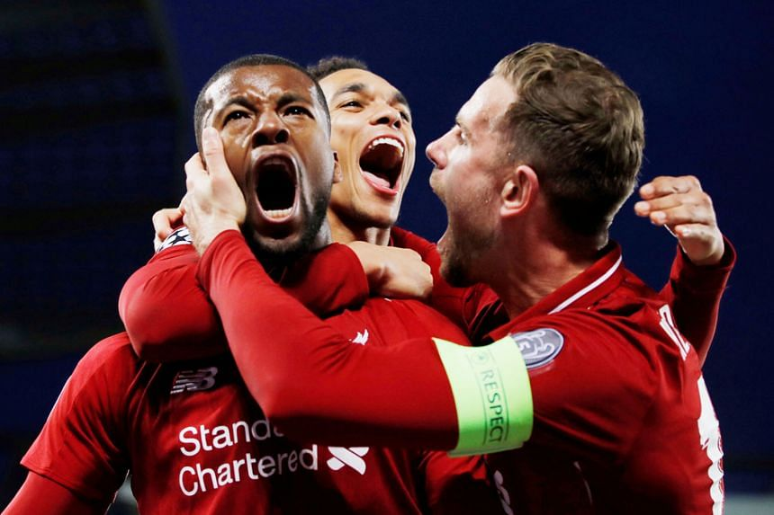 From left: Liverpool's Georginio Wijnaldum celebrating with Trent Alexander-Arnold and Jordan Henderson after scoring their third goal in the 4-0 Champions League semi-final, second-leg win over Barcelona on Tuesday. PHOTO: REUTERS