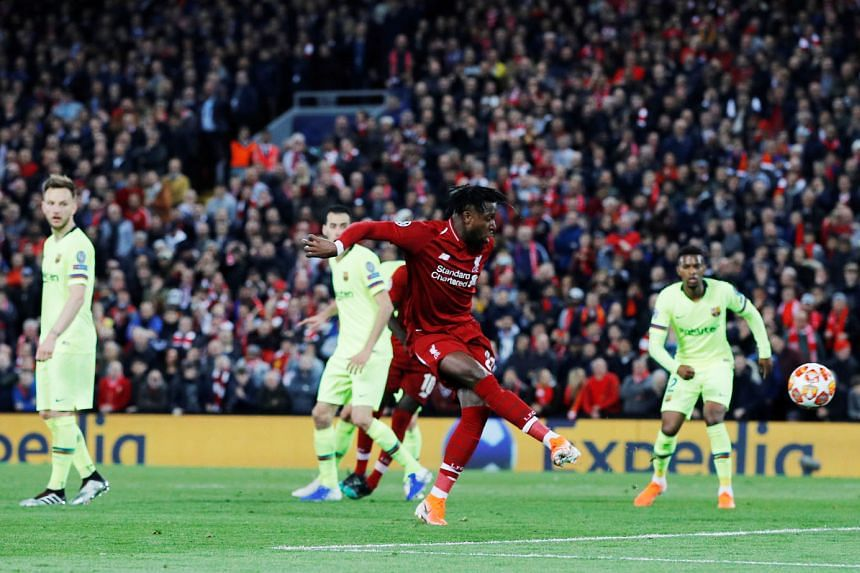 Liverpool's Divock Origi scoring their fourth goal from a quickly taken corner kick from Trent Alexander-Arnold which proved to be a stroke of genius. The Reds last won the Champions League in 2005.