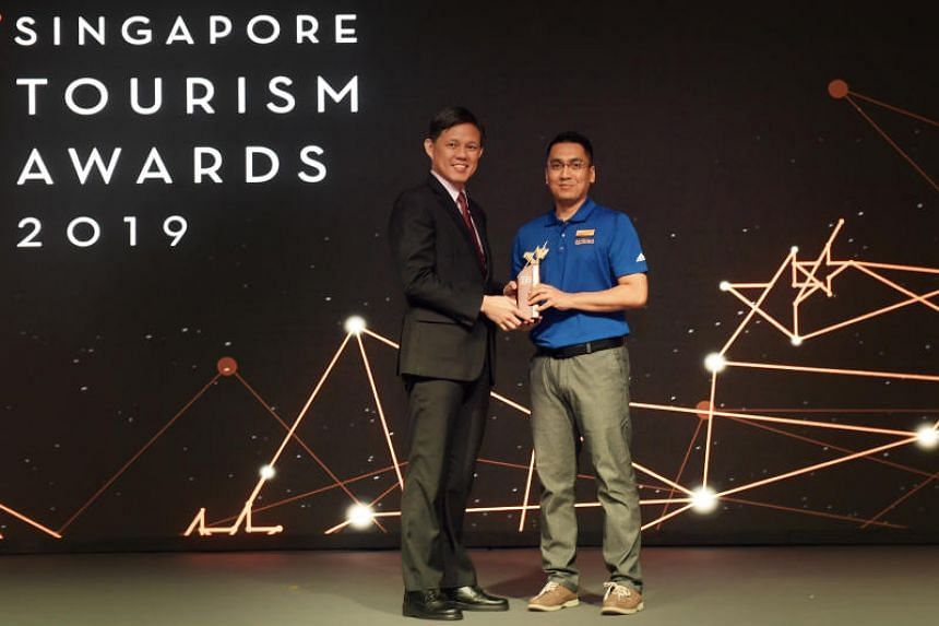 Mr Mohamed Farham Mohamed Noh, service ambassador and transport executive at Sentosa Leisure Management, receiving the Customer Service Excellence for Attractions Award from Trade and Industry Minister Chan Chun Sing during the Singapore Tourism Awar