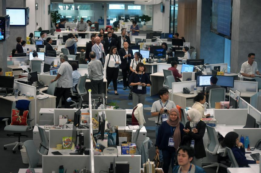 Journalists, editors, and other staff from media and marketing companies touring The Straits Times' newsroom on May 9, 2019,  as part of Publish Asia, an annual meeting of media professionals around the region that is organised by the World Associati