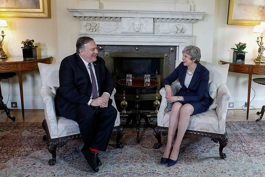US Secretary of State Mike Pompeo with British Prime Minister Theresa May ahead of their bilateral meeting in London on Wednesday. He warned that China posed a wide range of economic and security threats.