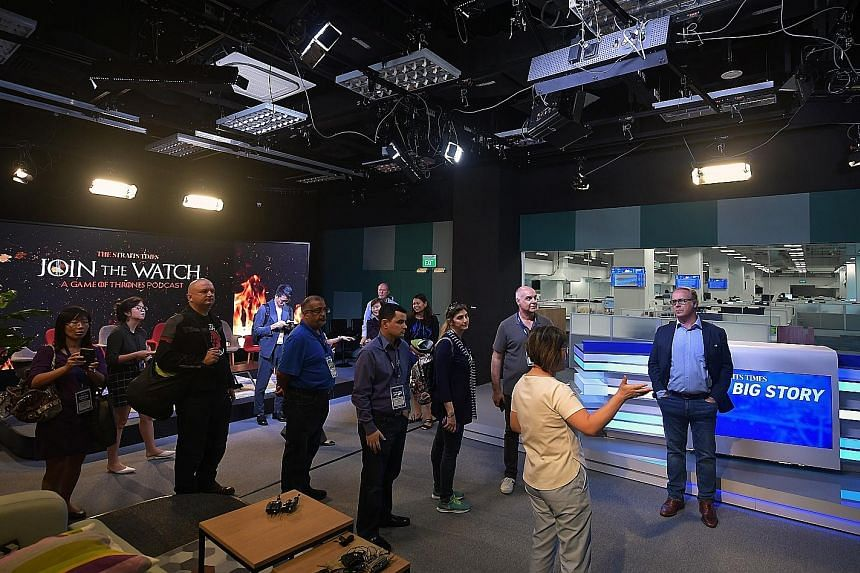 Delegates of Publish Asia 2019 getting a look at what goes on behind the scenes of The Straits Times' new daily talk show, The Big Story, in its broadcast studio.