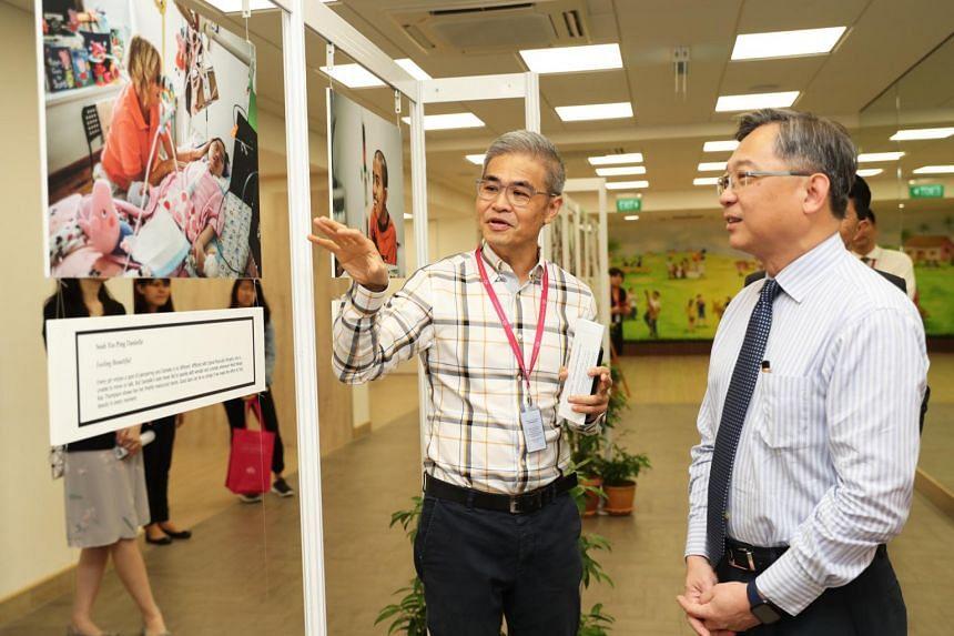 Health Minister Gan Kim Yong (right) with Dr Chong Poh Heng, medical director of HCA, at the new HCA Hospice Care premises at Kwong Wai Shiu Hospital.