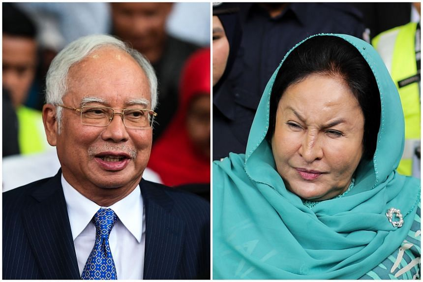 The suspension follows the graft, criminal breach of trust and money laundering charges brought against both former prime minister Najib Tun Razak (left) and his wife Rosmah Mansor.
