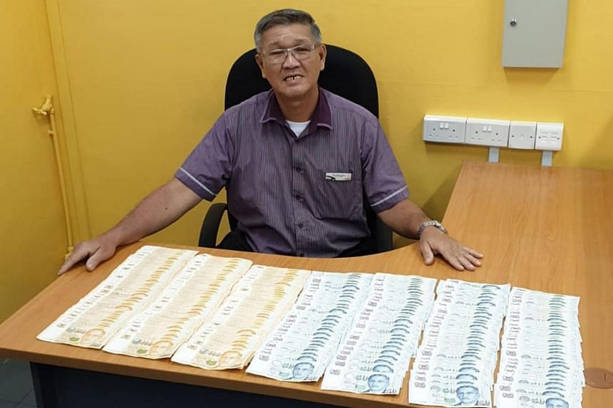 SBS Transit bus driver Saw Cheong Seng with the money left behind in the bus he was driving on May 10, 2019.