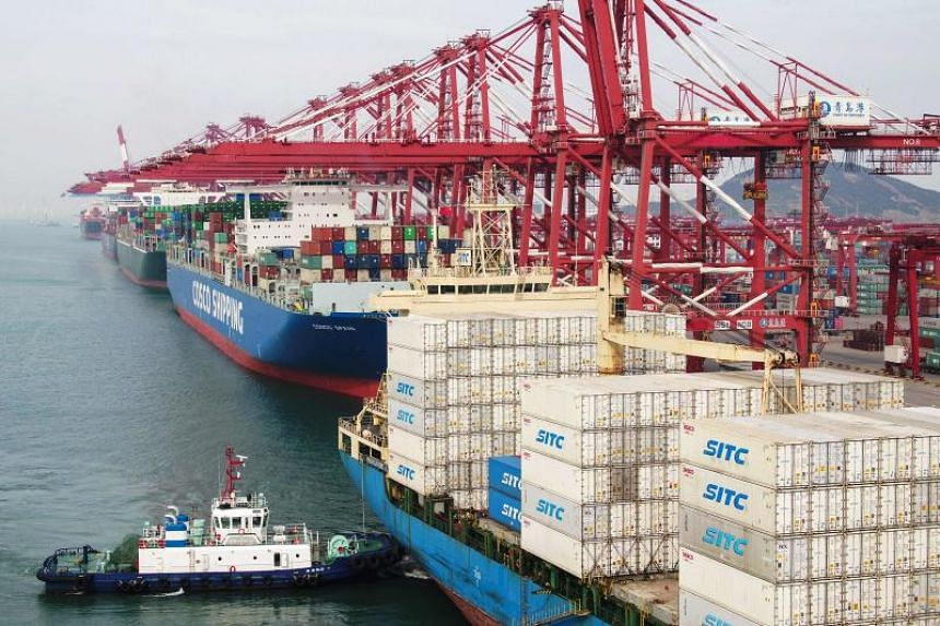 Cargo ships berth at a port in Qingdao in China's eastern Shandong province on May 8, 2019.