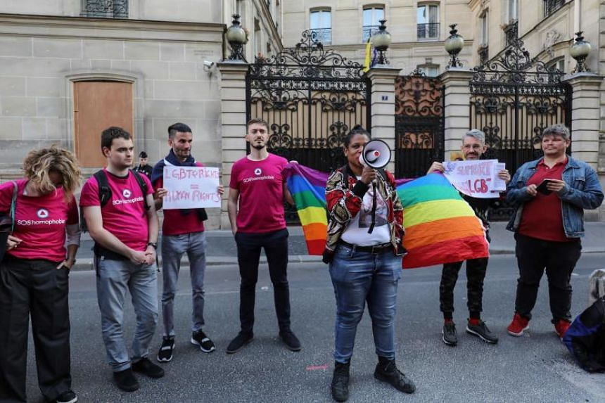 Gay activists shout slogans as they stage a protest in front of the Brunei embassy in Paris over the sultanate's new death penalty laws for gay sex and adultery, on April 18, 2019.