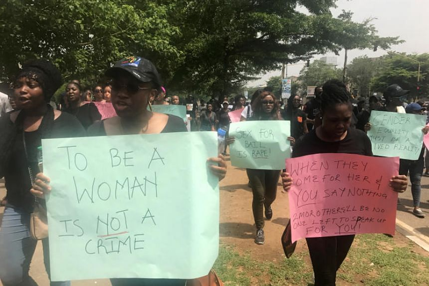 Protesters take part in a rally after police raided a night club in Abuja, Nigeria, on May 4, 2019.