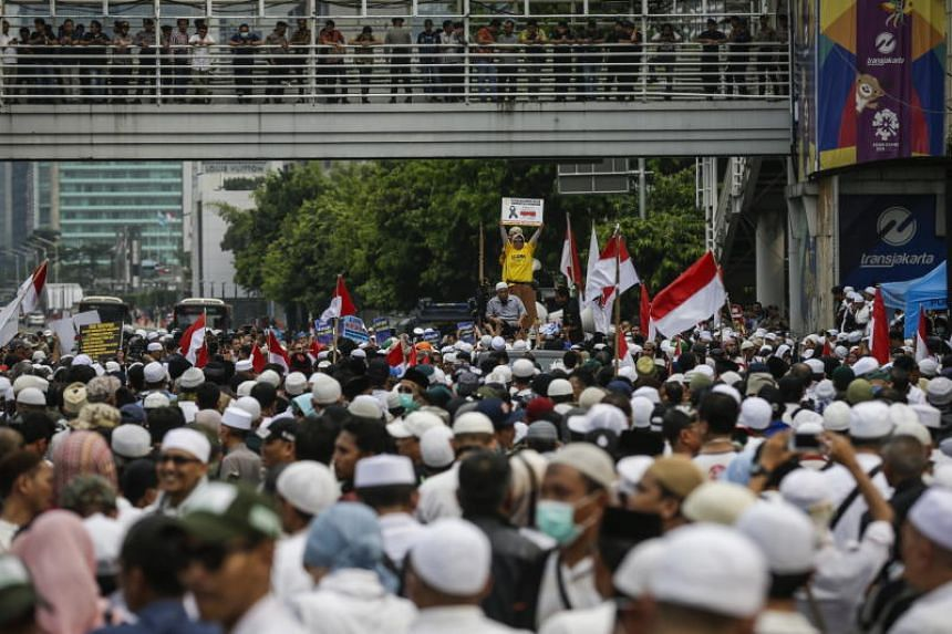 Supporters of Indonesian presidential candidate Prabowo Subianto at a rally outside the Elections Supervisory Agency building in Jakarta on May 10, 2019.
