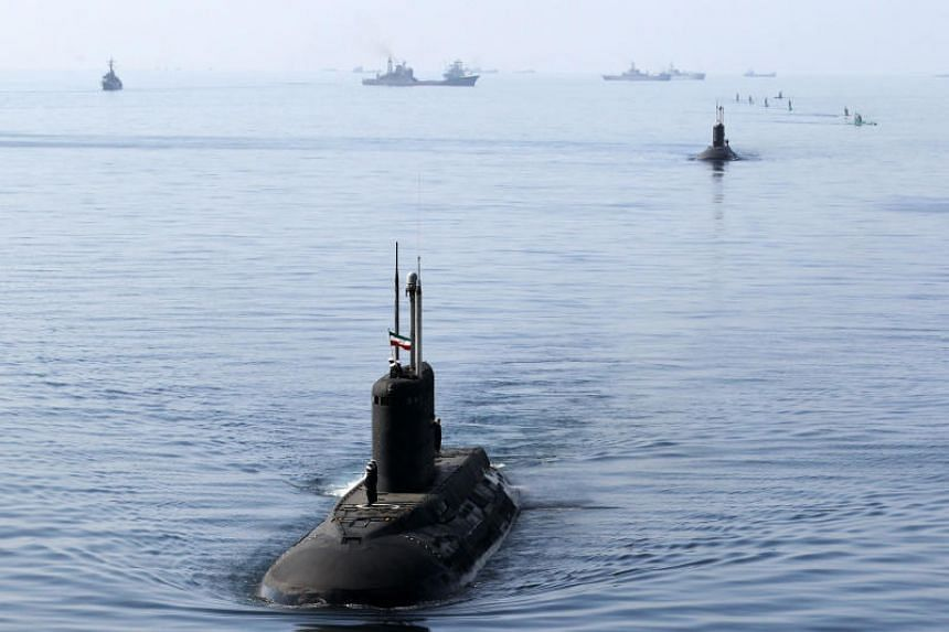 Submarines in the Strait of Hormuz in southern Iran during the Velayat-90 navy exercises on Jan 3, 2012.