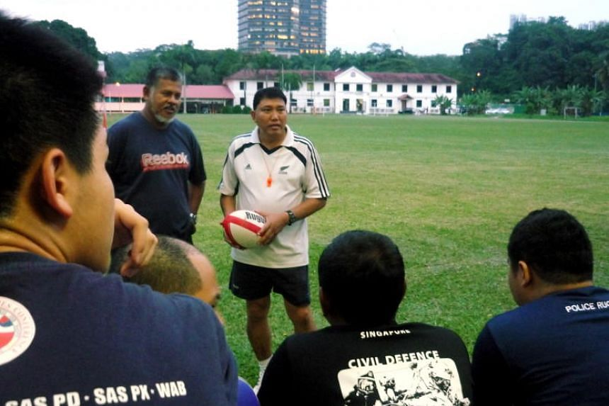 Former national rugby player Slemat Rakisan (facing camera, right) was pronounced dead at the scene by paramedics after he was thrown off his motorcycle in an accident on March 17, 2017.