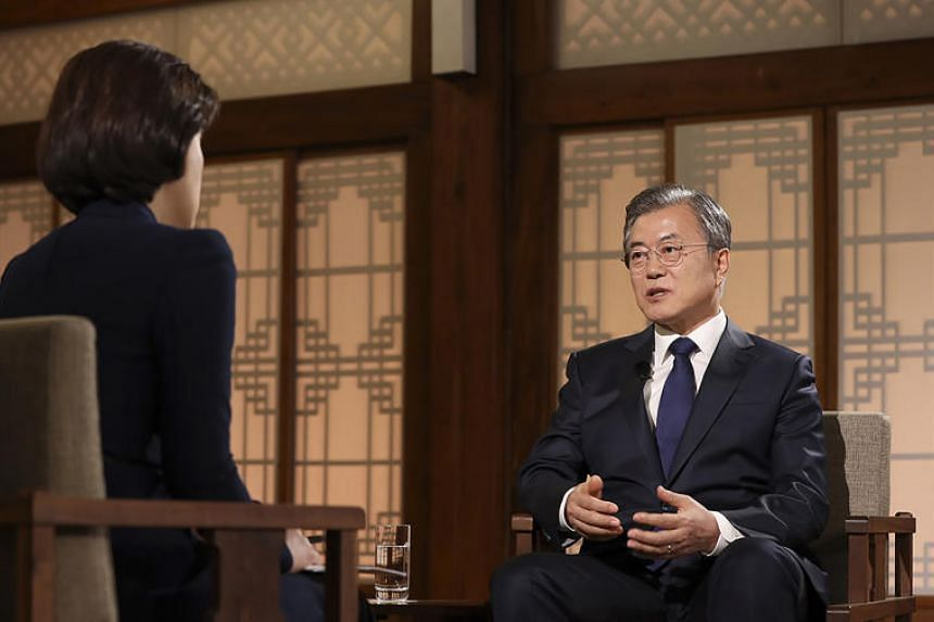 South Korean President Moon Jae-in (right) answering a question from reporter Song Hyun-jung during a live television interview at the presidential Blue House in Seoul on May 9, 2019.
