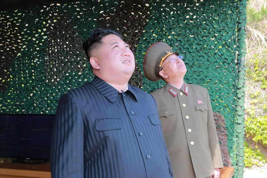 North Korean leader Kim Jong Un (left) supervising a 'strike drill' at an undisclosed location in North Korea, on May 4, 2019.