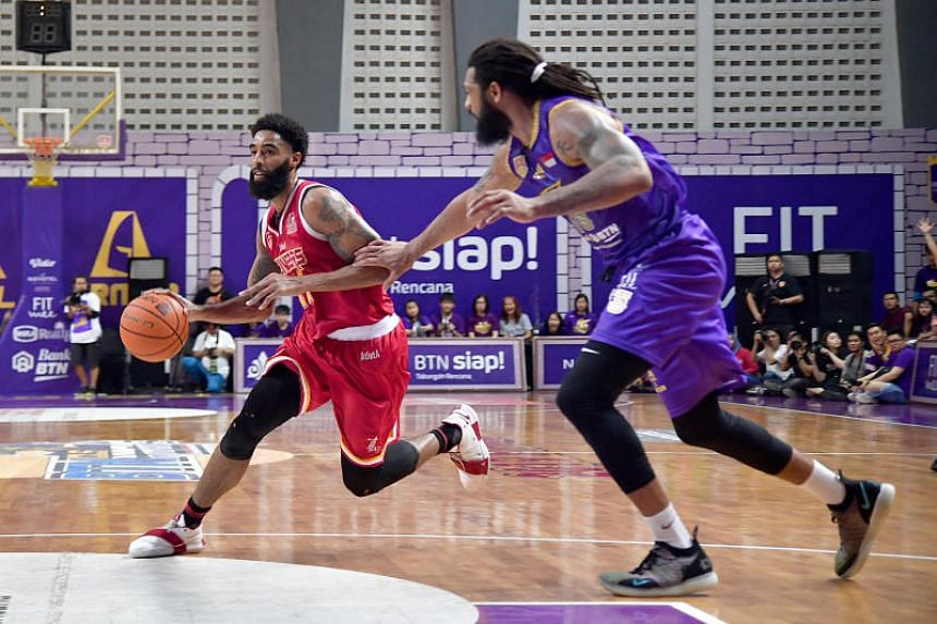 The Singapore Slingers' Jerran Young (left) made a difference in Game 3, scoring a team-high 16 points against the CLS Knights Indonesia.