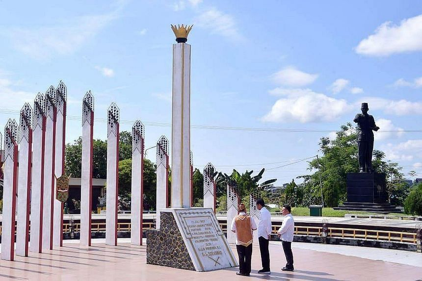 President Joko Widodo (centre) viewing a monument dedicated to Indonesia's founding father Sukarno in Palangkaraya, the capital of Central Kalimantan, this week. He was there as part of his search for a new capital city. Environmentalists worry that