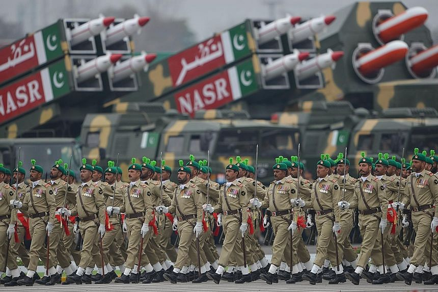 Troops marching during the Pakistan Day parade in Islamabad on March 23 this year. The Pakistani military does not tolerate dissent or criticism. PHOTO: AGENCE FRANCE-PRESSE