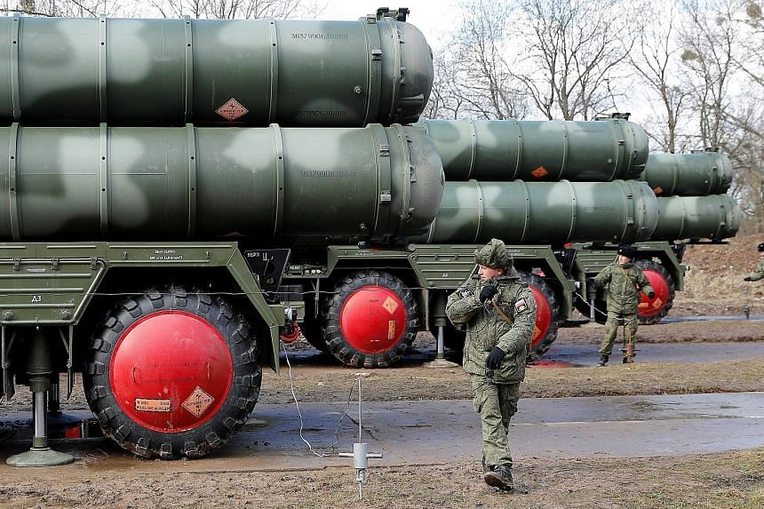 Russian servicemen next to a new S-400 Triumph surface-to-air missile system after its deployment at a military base outside a town near Kaliningrad in March. Instead of ordering the US-made Patriot, Turkish President Recep Tayyip Erdogan stunned his