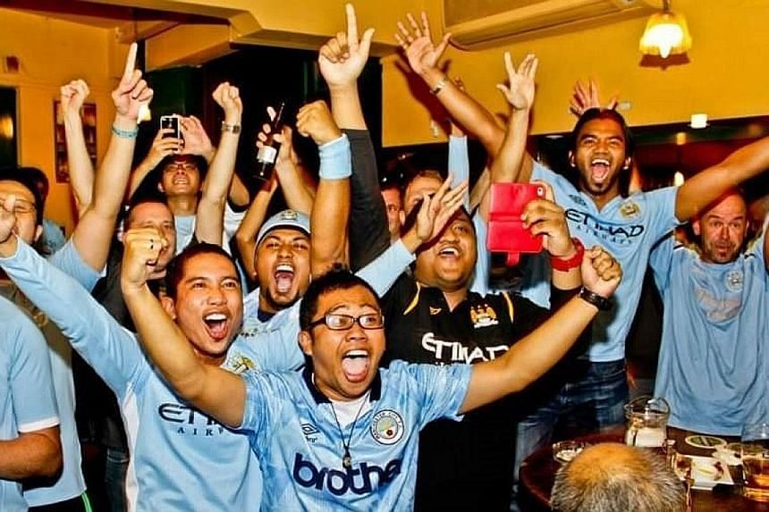 Left: Liverpool fan Aaron Kok (right), a travel agency owner who regularly organises trips to Anfield, will be at the Reds' home ground for the 17th time tomorrow - for the final game of the season against Wolves. Below left: Manchester City fans are