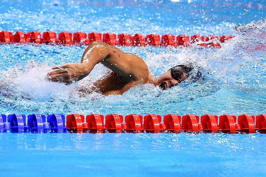 Toh Wei Soong clocking 1min 03.60sec in the 100m freestyle final at the OCBC Aquatic Centre last night. He had a multi-class score of 944 points that gave him the gold medal. ST PHOTO: LIM YAOHUI