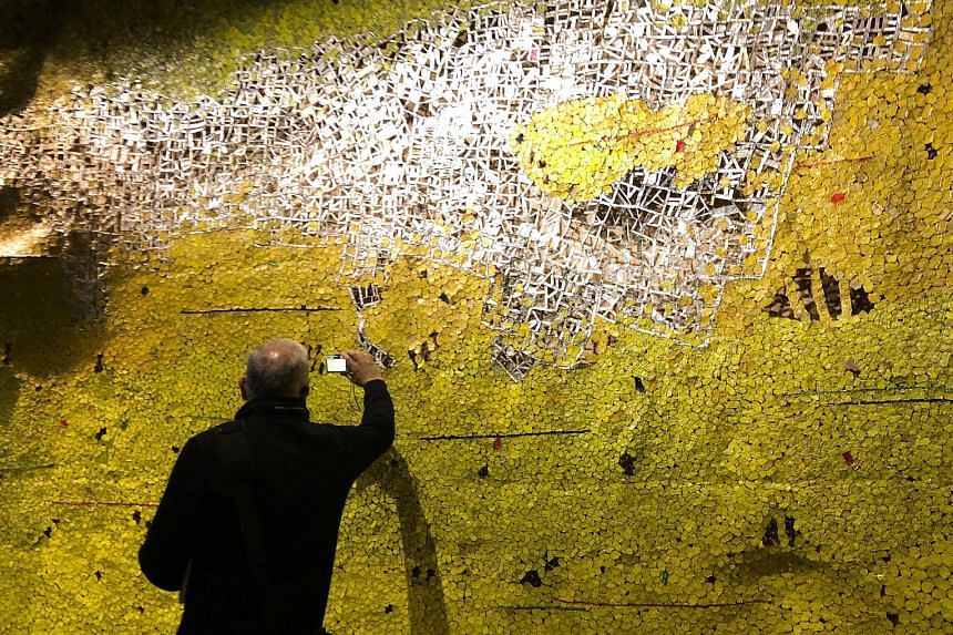 Earth Shedding Its Skin by artist El Anatsui at the Ghana pavilion.