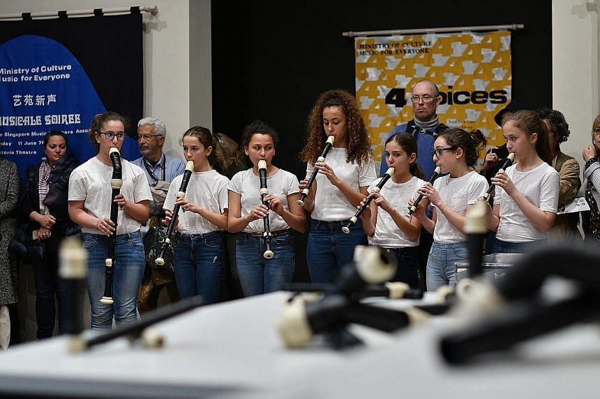 Students from the Istituto Comprensivo Dante Alighieri (Venezia) performing a composition inspired by the film, Recorder Rewrite, at the launch of the Singapore pavilion.