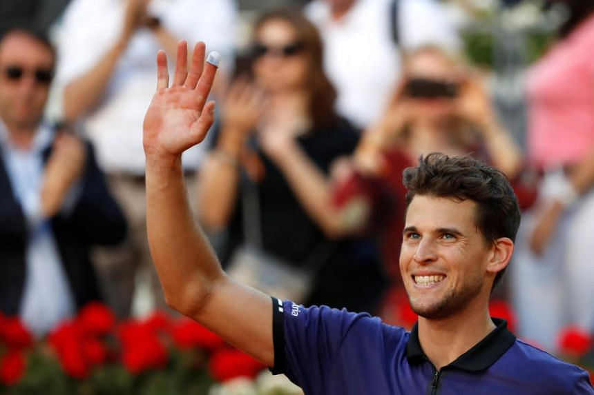 Austria's Dominic Thiem celebrates winning his quarter final match against Switzerland's Roger Federer.