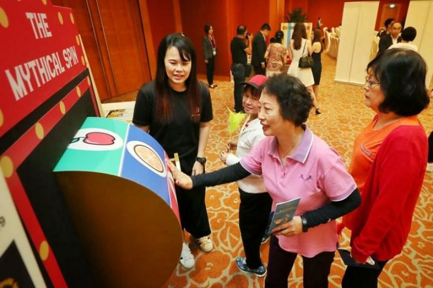 A guest at a game booth during the launch of the Responsible Gambling Awareness Week at the Resorts World Convention Centre on May 10, 2019.