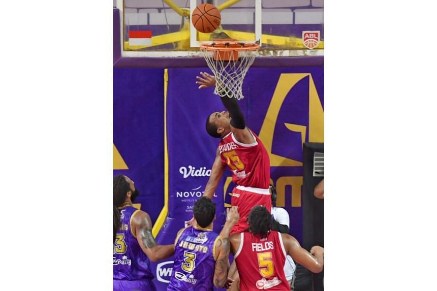 The Singapore Slingers' Xavier Alexander attempts to score against CLS Knights Indonesia in Game 4 of the Asean Basketball League Finals series in Surabaya on May 11, 2019.