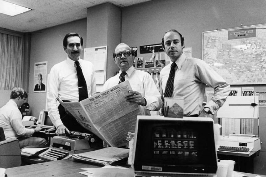 (From left) Mr Warren Phillips, Mr Ray Shaw and Mr Peter Kann in The Wall Street Journal's newsroom in Manhattan in 1979.