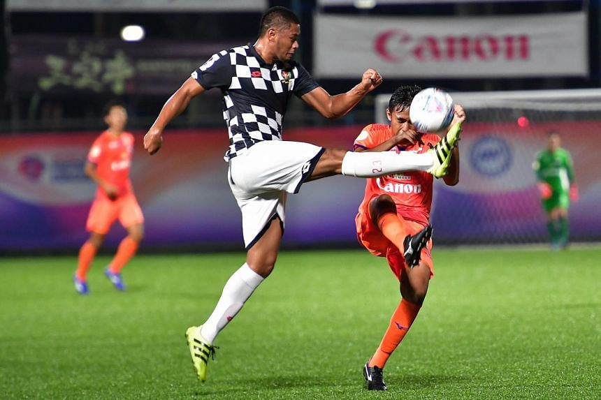 Brunei DPMM #23 Yura Indera Putera square off with Albirex Niigata #24 Zamani Zamri at Jurong East Stadium, on March 15, 2019.