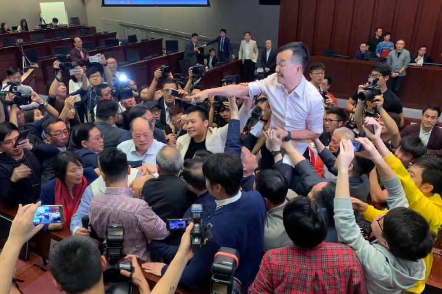 Hong Kong's pro-democracy lawmakers clashed with their pro-Beijing opponents when the two camps tried to hold separate hearings on the bill.